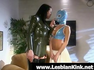 lesbians in rubber garments drubbing butts