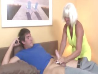 granny welcomes guy wtih a tugjob