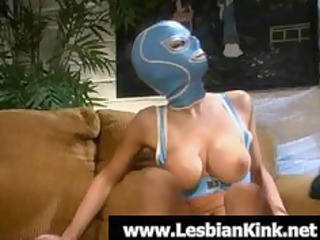 hawt lesbian in rubber mask engulfing a huge toy