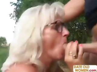 golden-haired romanian granny chomps on his cock