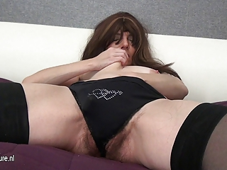 curly mature mother and her massive toy