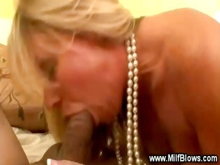 enchanting golden-haired cougar is sucking a penis