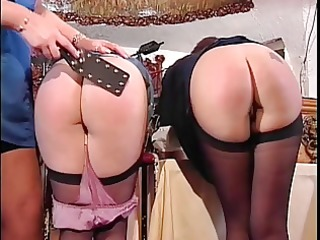 two cute booties getting spanked