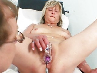 horny blonde granny toys her twat at gyno clinic