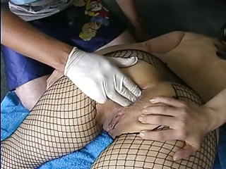 non-professional milf in fishnets anal fisting