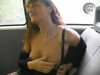 old woman gives an tugjob whilst masturbating in
