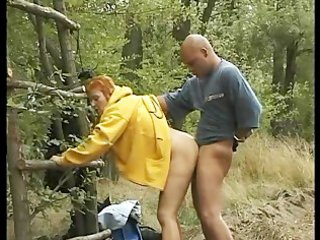 Readhead granny fucks outdoors