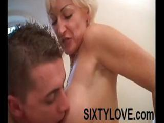 mature blonde mom is in the tub with a younger