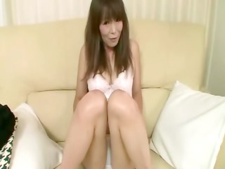 breasty oriental cougar getting naked