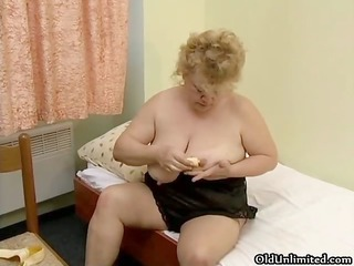 wicked fat housewife rubs a banana on her