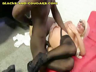 large titted cougar receives dark anal