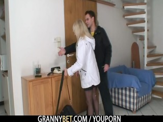 a guy bangs golden-haired granny