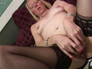 mature housewife playing with her old muff