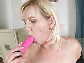 large titted blonde bonks and sucks her dildo.