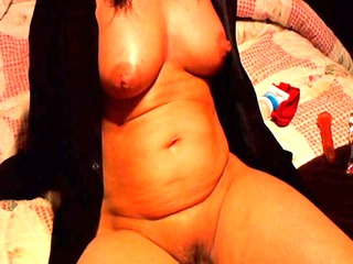 housewife plays with her self while watching porn