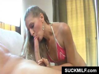 diminutive blonde milf is eating this cock with
