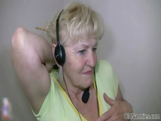 blond granny with large marangos dances stripped