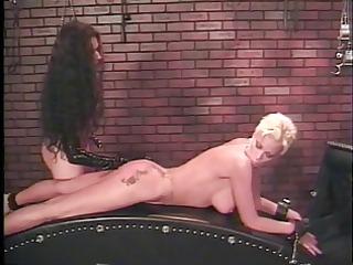 dominatrix uses hardcore toys on breasty blonde