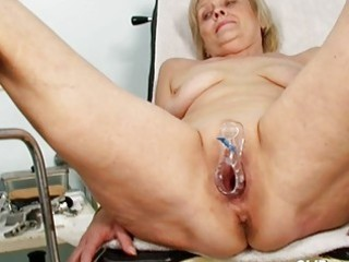 ribald blond granny receives her vagina gaped at