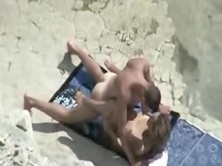aged beach fuck video scene of pair caught on