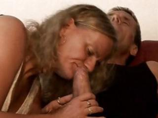 corpulent golden-haired granny nibbles on his